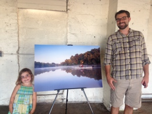 Watershed advocate Lee Cain and his daughter at the Anacostia pop-up gallery in Hyattsville.