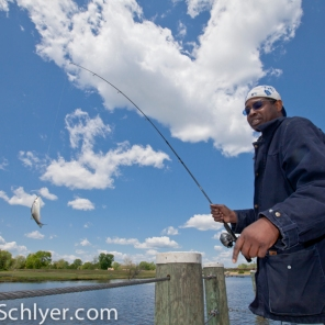 Charles Patrick fishing on the Anacostia River.